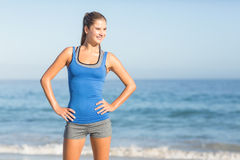 Portrait of beautiful fit woman with hands on hips Stock Photos