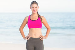 Portrait of beautiful fit woman looking at camera with hands on hips Stock Photo