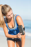 Portrait of beautiful fit woman using her phone Royalty Free Stock Image