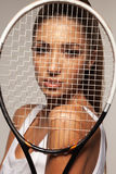 Portrait of beautiful fitness sexy woman, tennis player with racket. Stock Photos
