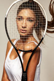 Portrait of beautiful fitness sexy woman, tennis player with racket. Stock Photography