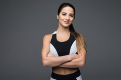 Portrait of a beautiful fitness woman with crossed arms Royalty Free Stock Photo