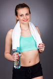 Portrait of beautiful fitness woman holding  a bottle of water Stock Photography