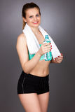 Portrait of beautiful fitness woman holding a bottle of water Royalty Free Stock Image