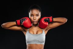 Portrait of a beautiful fitness woman standing in boxing gloves Stock Images