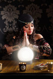 Portrait of a beautiful fortune-teller. In the darkness Royalty Free Stock Image