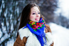 Portrait of beautiful frozen smiling woman in winter forest Royalty Free Stock Photography