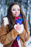 Portrait of beautiful frozen smiling woman in winter forest Royalty Free Stock Image