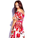 Brunette woman girl going crazy in colorful bright summer red dress Royalty Free Stock Photos