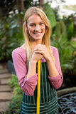 Portrait of beautiful gardener with hand tool at garden Royalty Free Stock Photography
