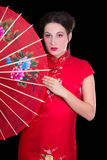 Portrait of beautiful geisha in red japanese dress with fan. Portrait of young beautiful geisha in red japanese dress with fan Stock Image