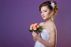 Portrait of a beautiful gentle and elegant girl women bride in a white dress with a beautiful hairstyle and makeup stock image