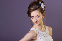 Portrait of a beautiful gentle and elegant girl women bride in a white dress with a beautiful hairstyle and makeup royalty free stock images