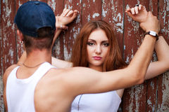 Portrait of a beautiful ginger girl standing with a man over woo Stock Photography