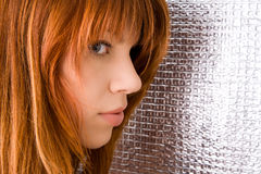 Portrait of beautiful ginger-haired woman Royalty Free Stock Image