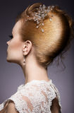 Portrait of a beautiful ginger woman in the image of the bride. Hairstyle back view Royalty Free Stock Photo