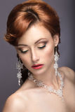 Portrait of a beautiful ginger woman in the image of the bride. Royalty Free Stock Photo