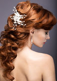 Portrait of a beautiful ginger woman in the image of the bride. Royalty Free Stock Photography