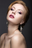 Portrait of a beautiful ginger woman in the image of the bride. Stock Image