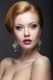 Portrait of a beautiful ginger woman in the image of the bride. Stock Photos