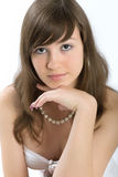 Portrait of the beautiful girl. The young girl in a white blouse and in a beads royalty free stock images