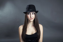 Portrait of beautiful girl. Portrait of young girl thinking with hat royalty free stock image