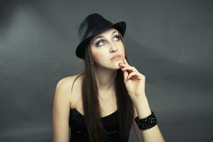 Portrait of beautiful girl. Portrait of young girl thinking with hat stock images