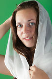 Portrait of the beautiful girl. On a green background Stock Photo