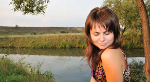 Portrait of the beautiful girl against lake Stock Images