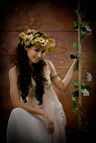 Portrait of beautiful girl in antique dress. Lie on swing Stock Image