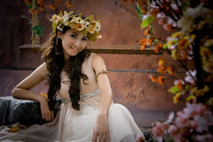 Portrait of beautiful girl in antique dress. Lie on swing Stock Photos