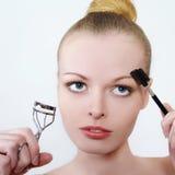 Portrait of the beautiful girl applying make up Stock Image