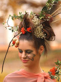 Portrait of beautiful girl with autumn leaves and with stylish m Royalty Free Stock Photos