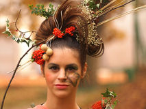 Portrait of beautiful girl with autumn leaves and with stylish m Royalty Free Stock Photography