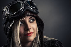 Portrait of a beautiful girl in aviator helmet Royalty Free Stock Images