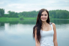 Portrait of a beautiful girl in the background of a lake royalty free stock images