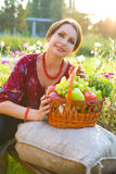 Portrait of the beautiful girl with a basket of fruit and vegeta Stock Photography