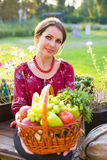Portrait of the beautiful girl with a basket of fruit and vegeta Royalty Free Stock Photos