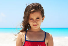 Portrait of a beautiful girl in the beach. Portrait of a beautiful caucasian girl smiling in the beach Royalty Free Stock Photo