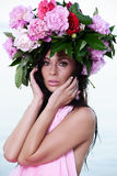 portrait of a beautiful brown-haired woman in a flower wreath Stock Photo