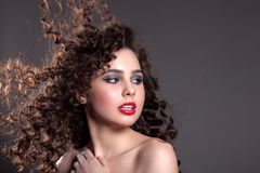 Portrait of a beautiful girl with a beautiful hair and makeup on stock photos