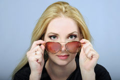 Portrait of the beautiful girl bespectacled Stock Images