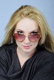 Portrait of the beautiful girl bespectacled Royalty Free Stock Images