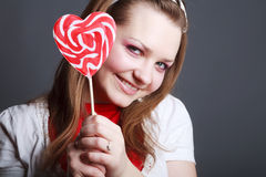 Portrait of beautiful girl with big lollipop Royalty Free Stock Images