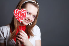 Portrait of beautiful girl with big lollipop Stock Photos