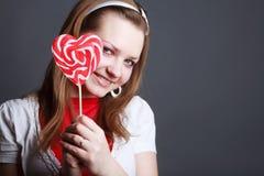 Portrait of beautiful girl with big lollipop Stock Photos