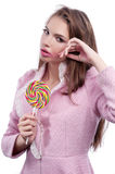 Portrait of a beautiful girl with big lollipop. Royalty Free Stock Photography