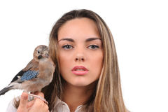 Portrait of beautiful girl with bird Stock Images