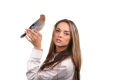 Portrait of beautiful girl with bird Stock Photo