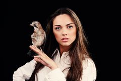 Portrait of beautiful girl  with bird on the hand Stock Photos